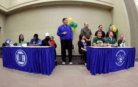 Senior football players sign letters of intent