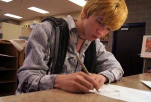 Student artist Josh Loyd illustrates his talent