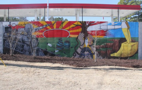 The colorful Kum & Go mural depicts Saline County's diverse history. | photo Paige Staggs