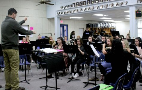 Wind Ensemble rehearses under the direction of Keith Matthews during seventh period. While the pit orchestra for Beauty and the Beast is comprised of Wind Ensemble members, recent hire Josh Gardner will be leading the group instead of Matthews.