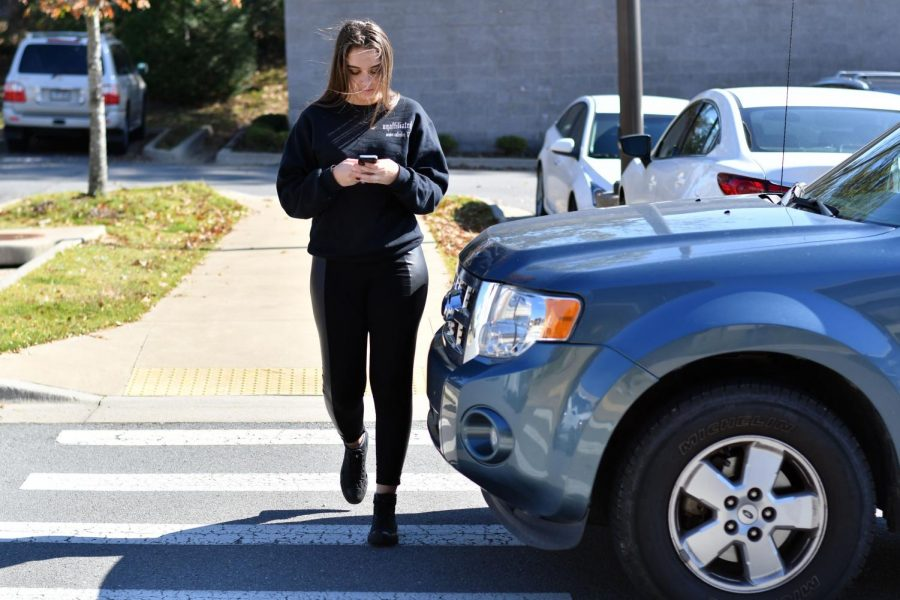 Distracted+by+her+phone%2C+senior+Madison+Green+almost+gets+hit+by+an+incoming+driver.