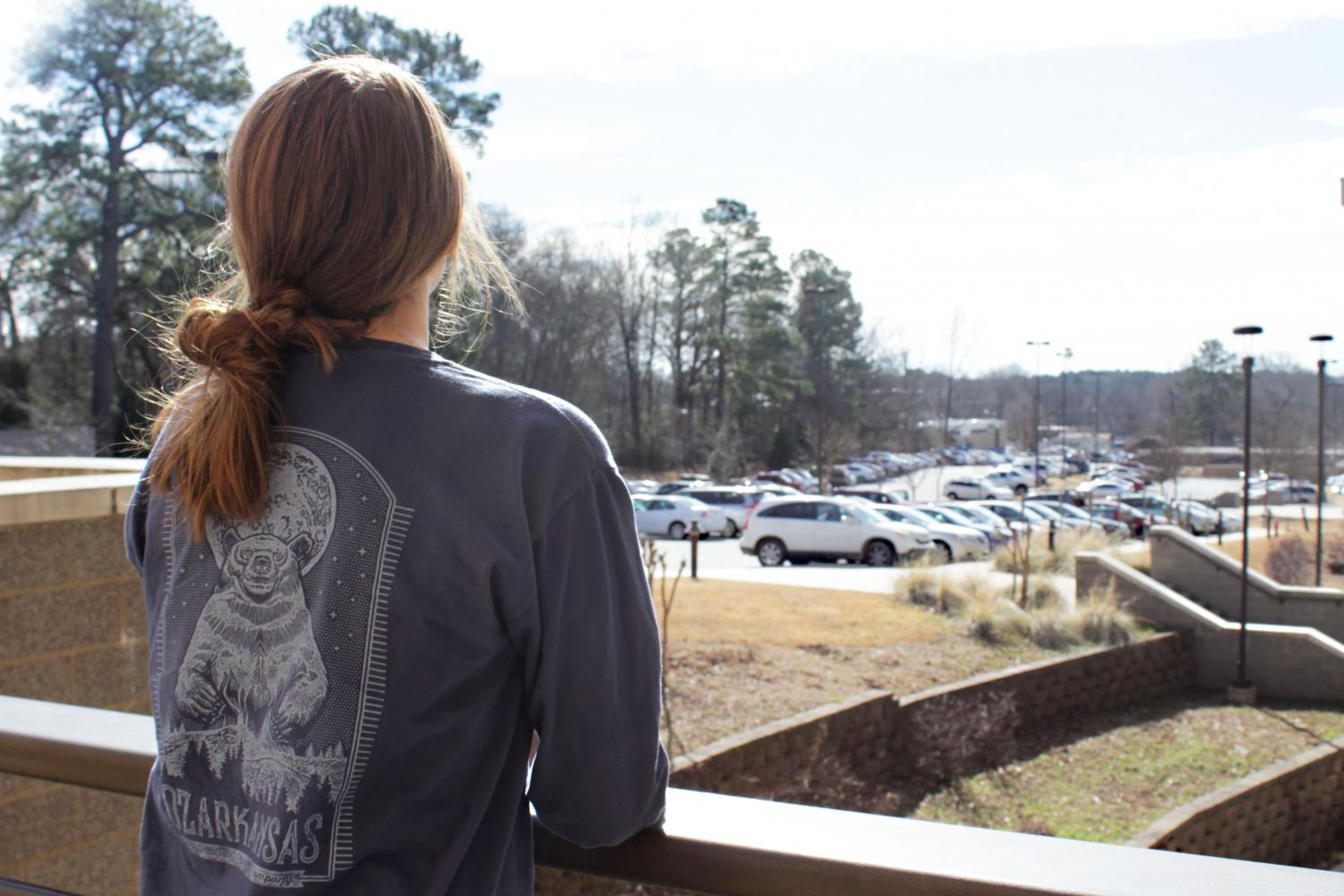 Joslyn Graves looks out over the main parking lot.