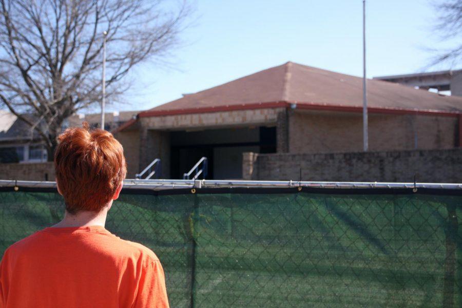 Michael Fuhrman peers over the gate blocking off Love Auditorium.