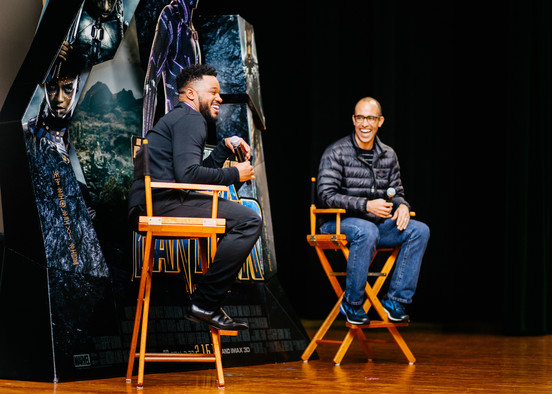 """Black Panther"" director Ryan Coogler, left, and executive producer Nate Moore speak with audience members during a Q&A session at the theater on Joint Base Andrews, Md., Feb. 11, 2018. The duo facilitated a free military appreciation showing after the Q&A session as a way to give back to service members and their families. (U.S. Air Force photo by Senior Airman Delano Scott) (Photo by Senior Airman Delano Scott)"