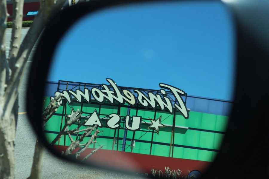 Tinseltown from the view of a side mirror.