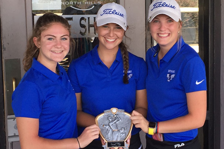 From the left Freshman Caitlin LaCerra, Junior Meredith Medford and Junior Brooklyn Waller pose with their second place trophy at the North Little Rock Invitational