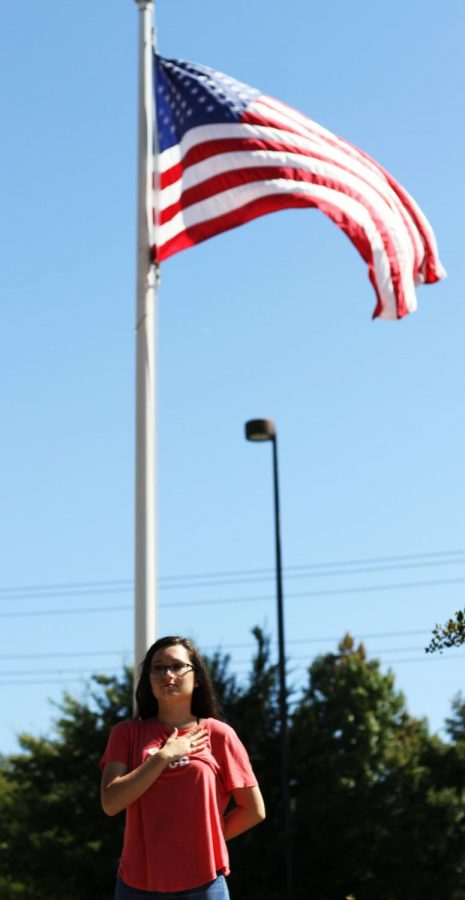 Standing+in+front+of+the+flag+pole%2C+senior+Jaiden+Kubana+recites+the+pledge+in+