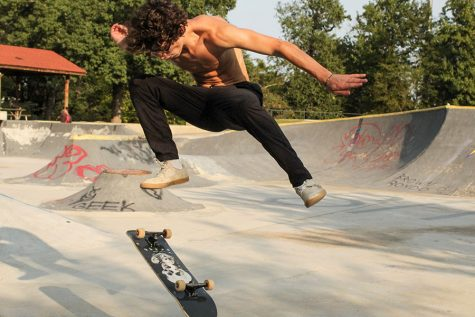 "Toward the end of his skate session at Kanis Park Sept. 19, sophomore Sam Peck attempts to land a dolphin flip. Peck first learned the trick a year ago. ""It took me a few hours, because I was completely new to that trick,"" Peck said."