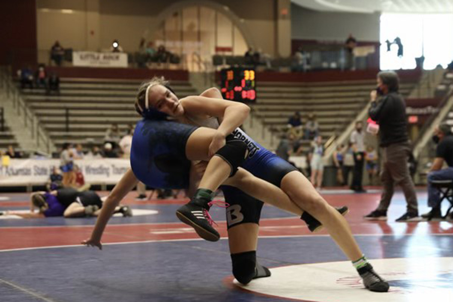 At the state wrestling tournament, sophomore Presley Givens takes down an opponent. Givens was the only female wrestler on the team.