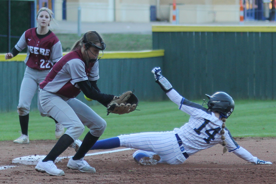 "At the game against Beebe March 2, junior Caitlin LaCerra steals third base. LaCerra is leading the team in stolen bases this season. ""Stealing bases has a lot to do with being able to read the defense to see when the next base is open,"" LaCerra said."