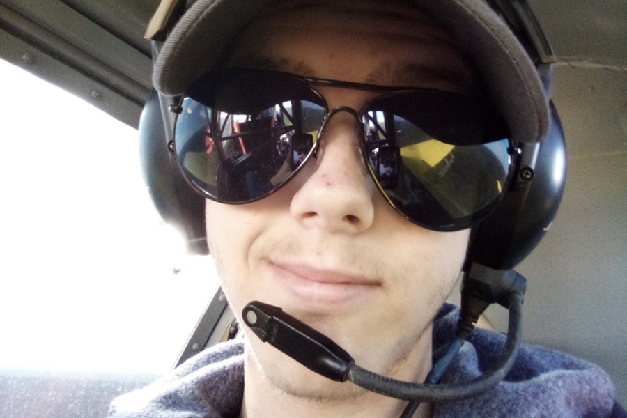 In a crop duster, junior Caleb Heimbach flies over his familys land near Helena.